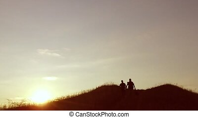 people group of tourists walking on top of a sunset travel silhouette mountain. slow video tourists people group go nature