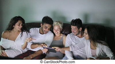 People Group Sitting On Couch Using Tablet Computer Watching...
