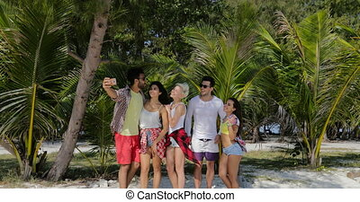People Group Take Selfie Photo On Cell Smart Phone On Beach...