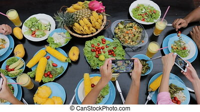 People Group Taking Photos Of Healthy Vegetarian Food On Cell Smart Phones Top Angle View, Friends Eating Sitting At Table