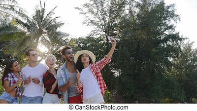 People Group Taking Selfie Photo On Cell Smart Phones...