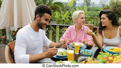 People Group Talk Eating Healthy Vegetarian Food, Friends Communication Sitting At Table On Tropical Terrace