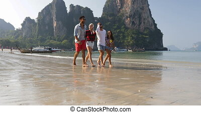 People Group Walking On Beach Talking Two Couples Holding Hands Happy Cheerful Men And Women Tourists On Vacation