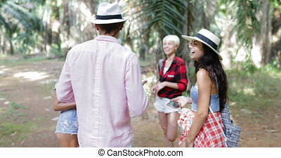 People Group With Backpacks Talking Using Cell Smart Phones, Men And Woman Laughing On Trekking In Tropical Palm Tree Forest