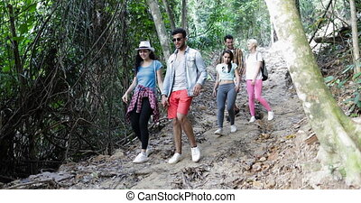 People Group With Backpacks Trekking On Forest Path Walk...