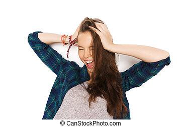 happy pretty teenage girl holding to head