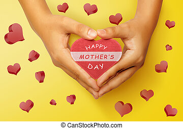 People hand holding heart with Happy Mothers day greeting
