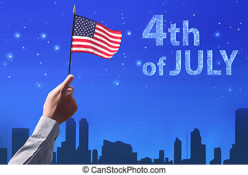 People hand holding the flag of USA celebrating 4th of July