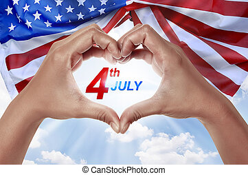People hand in shape of heart with 4th of July message