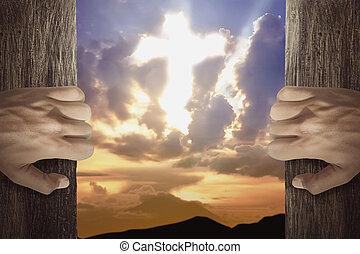 People hand open the door with cross shaped in the sky
