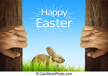 People hand opening wooden door with easter bunny and happy easter greeting