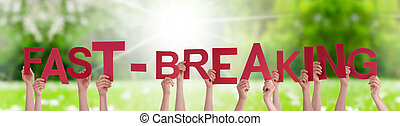 People Hands Holding Word Fast-Breaking, Grass Meadow
