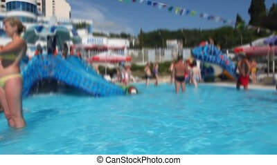 people has fun in water park, panning 360 degrees, blurred...
