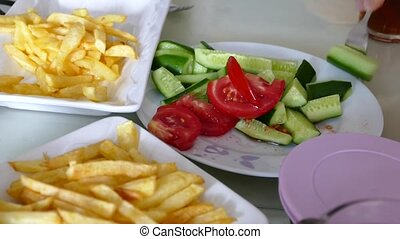 people having breakfast, table and fries, French fries and ...