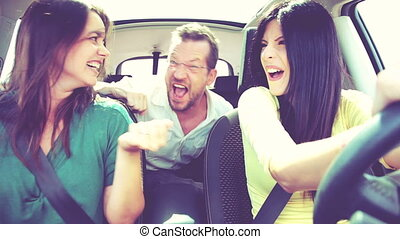 People having fun in car