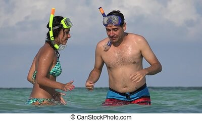People Having Fun In The Ocean Swimming With Snorkels