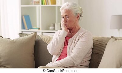 unhappy woman suffering toothache at home - people,...