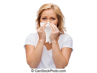 unhappy woman with paper napkin blowing nose