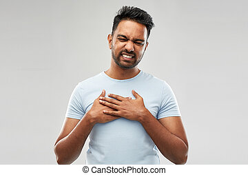 unhappy indian man suffering from heartache - people, heart...
