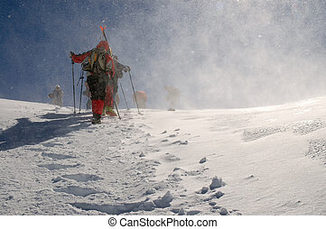 People hiking in beautiful winter mountains