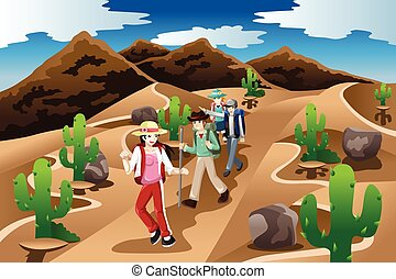 People Hiking in the Desert