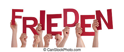 People Holding German Word Frieden Means Peace