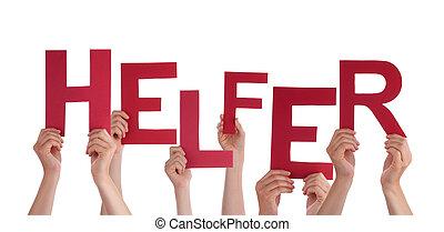 People Holding German Word Helfer Means Helper