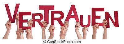 People Holding German Word Vertrauen Means Trust