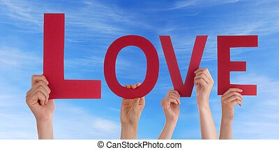 Many People Holding the Word Love in the Sky