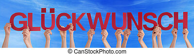 People Holding Straight German Word Glueckwunsch Means Congratul