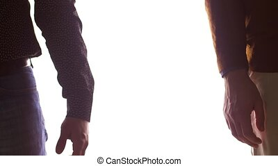 close up of male gay couple holding hands - people,...