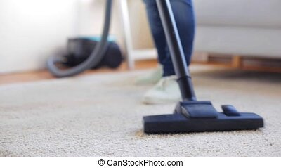 woman with vacuum cleaner cleaning carpet at home - people, ...