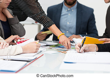People in a business meeting - View of the hands of a group...