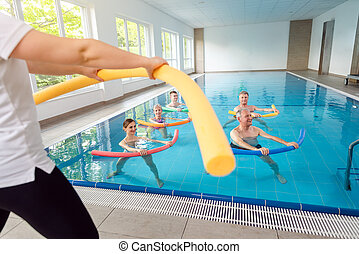People in aqua fitness class during a physical therapy session