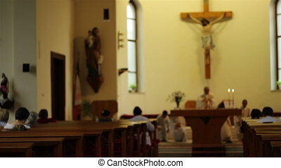 People in Benches Praying in Church