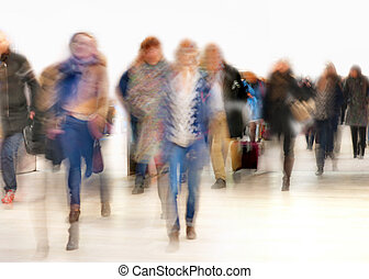 People in blurred motion in a hurry