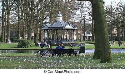 people in city park, springtime