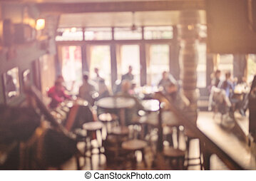 People in Coffee shop blur background with bokeh lights, vintage filter for old effect, blurred background
