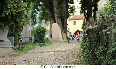 People in Graveyard - People visit a famous old cemetery...