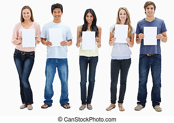 People in jeans holding five signs