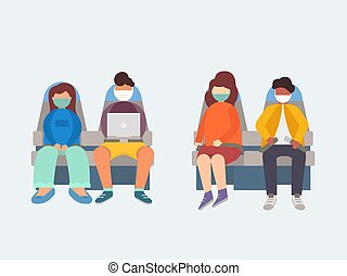 People in medical masks sit on the plane.