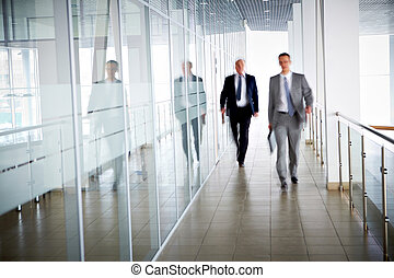 People in office - Business people walking in the office...