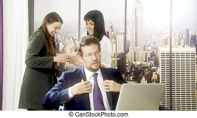 People in office having fun - Two women in office making fun...
