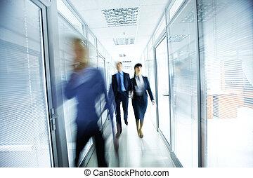 People in office - Business people walking in the office...