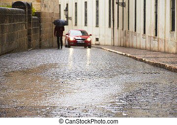 People in rain - City street in heavy rain - selective focus