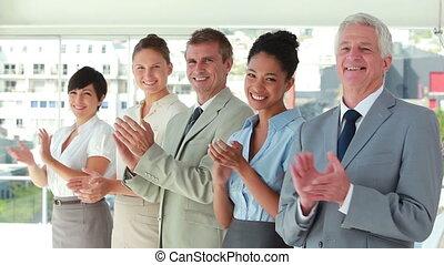 People in suit applauding in line