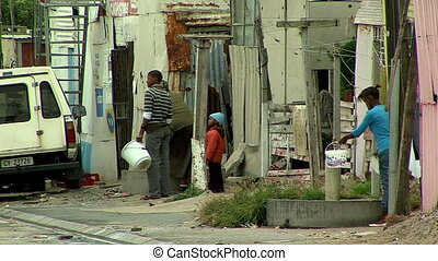 people in the street in a township, south africa - south...