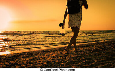 people in the sunset beach
