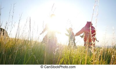 People in traditional russian clothes walking in a circle and having fun at bright summer day