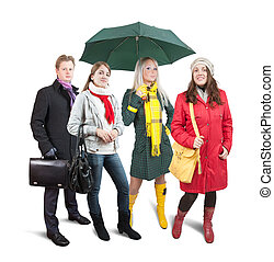 People  in wintry clothes with bag